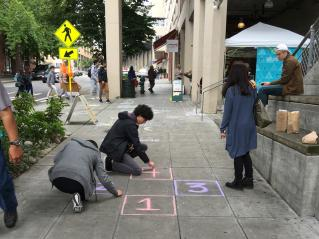 Hop Scotch setup in the midst of our block-long sidewalk chalk project. Photo by Michaela Rose.